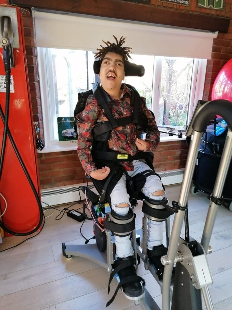 Freddie exercising at home powerchair 2020