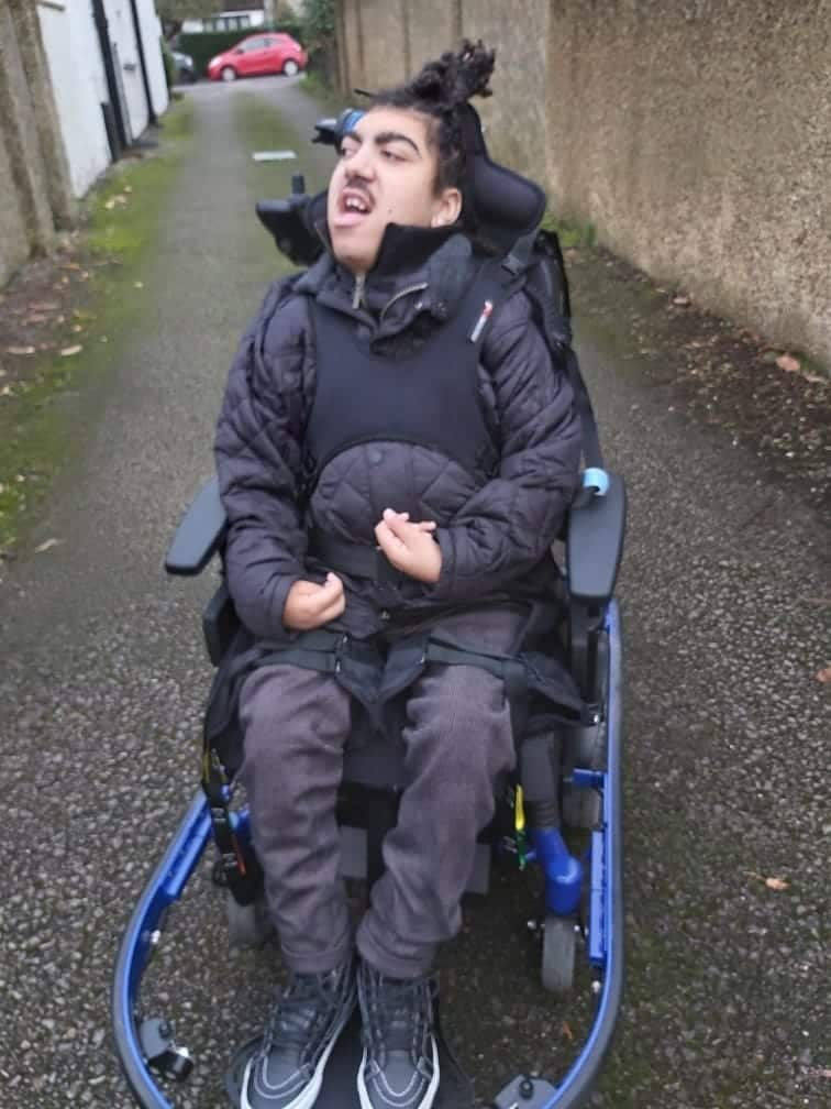 Freddie controlling his Smile powerchair